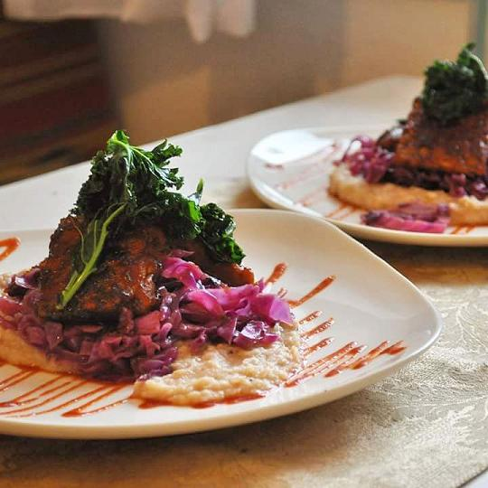 Maple-Sriracha Seared Tempeh over Cannelini Bean Puree with Braised Red Cabbage and Crispy Kale